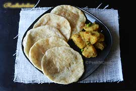 Radha Ballavi Or Bengali Lentil Stuffed Deep Fried Flat Bread