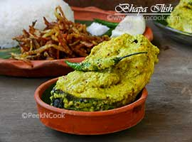 Sorshe Bhapa Ilish Or Steamed Hilsha In Mustard Gravy